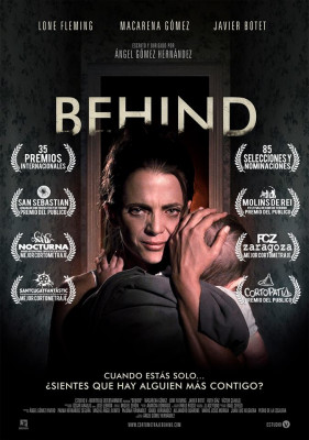 Behind poster